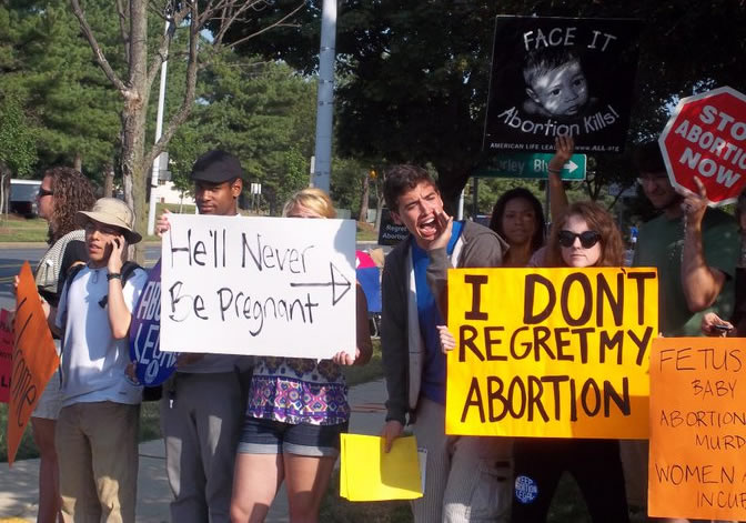 Anti-choice harassment outside of Dr. Carhart's clinic accompanied by pro-choice presence.